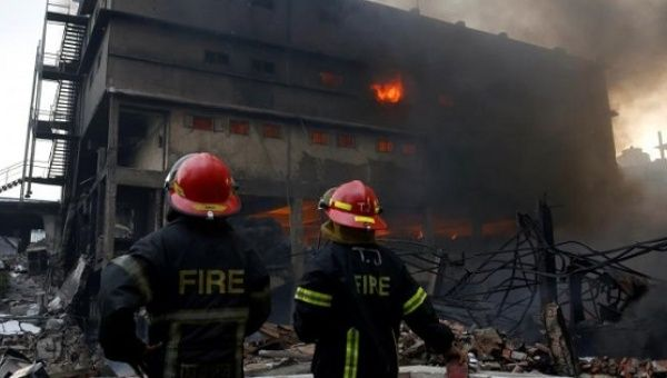 Bangladesh struggles to search factory after deadly fire