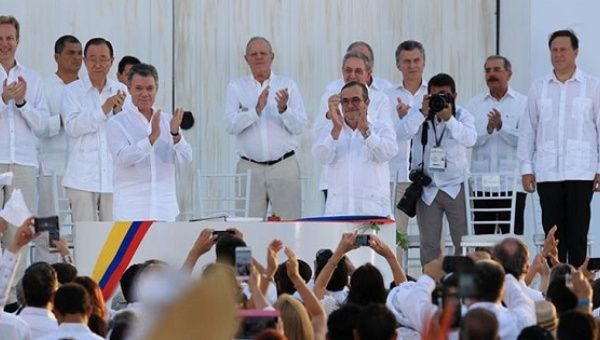 Colombia inks accord with Marxist rebels, ending 52-year war