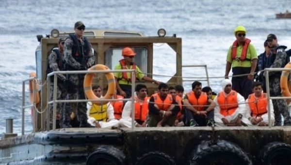 Australia would deny entrance to boat arrivals under proposed law