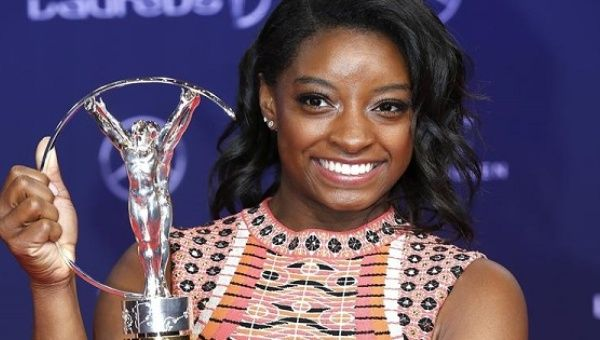 U.S. gymnast Simone Biles poses with the Laureus Sportswoman of the Yea award at the Laureus Sport Awards in Monaco Feb. 14 2017