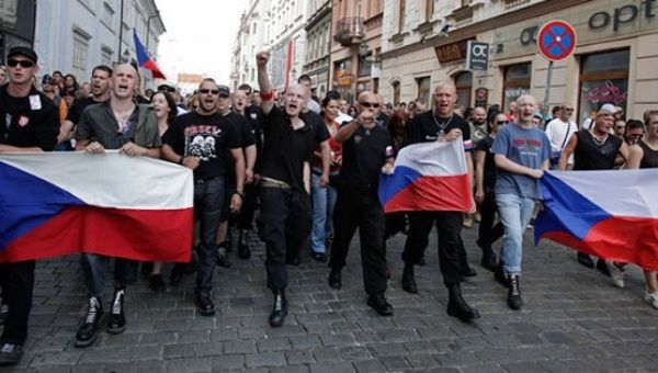 Far-right Czech activists shout as they march in protest against the Roma minority in Plzen