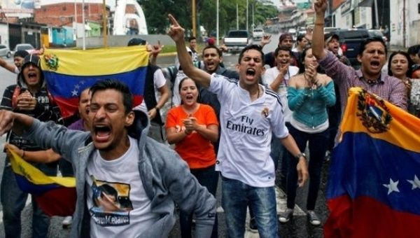 Venezuela protesters bring 'poo bombs' to hurl at cops