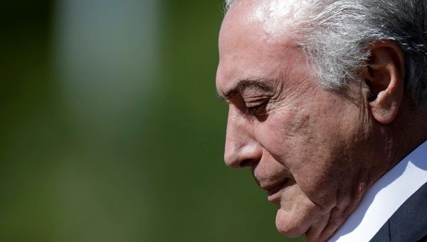 Brazil's electoral court keeps Temer in office