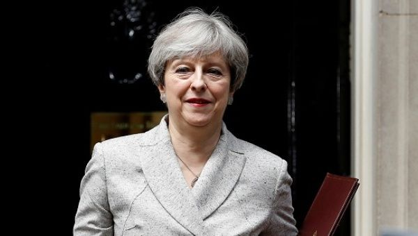 London fire could delay deal between UK PM May's Conservatives and DUP