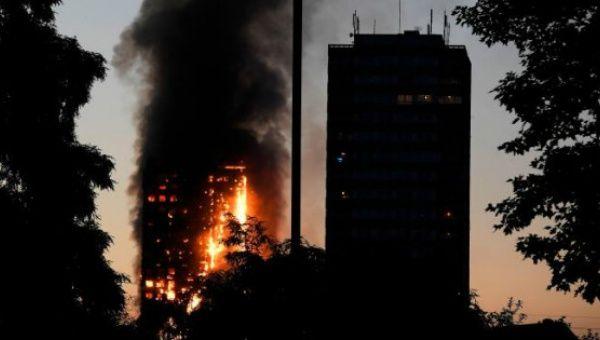 Fire razes block of flats in London