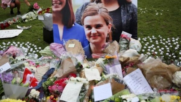 Tributes in memory of murdered Labour Party MP Jo Cox who was shot dead in Birstall are left at Parliament Square in London Britain