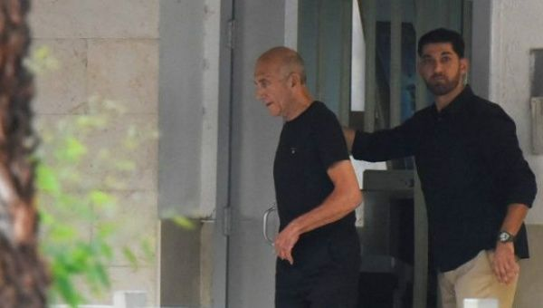 Ehud Olmert, Israel's jailed ex-PM, is released early
