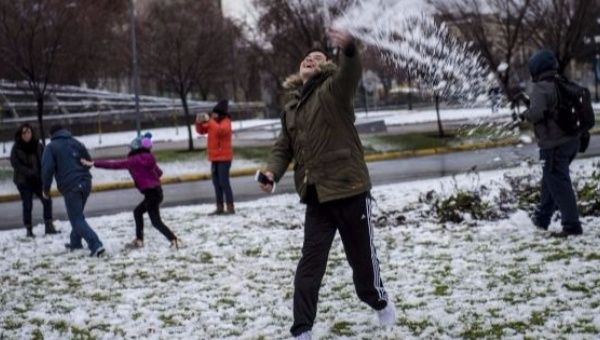 One dead, widespread blackouts in Chilean capital after rare snowfall