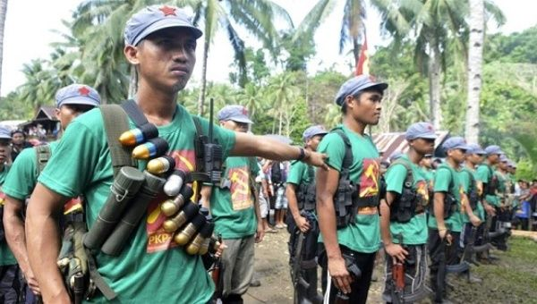 Philippine presidential guards hurt in clash with rebels