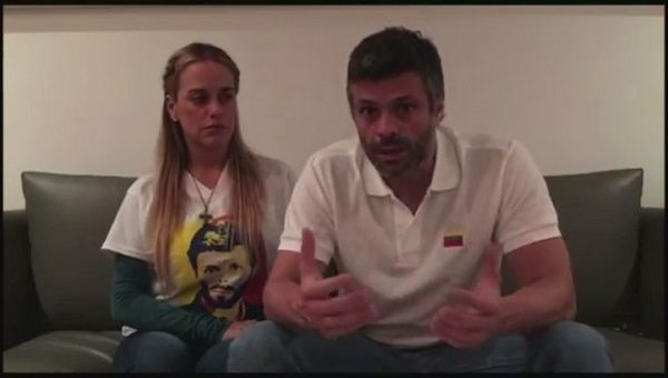 Leopoldo Lopez and his wife Lilian Tintori talking in their house in Caracas Venezuela