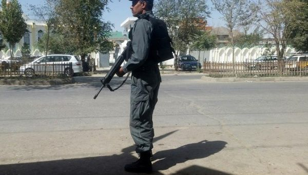 An Afghan policeman keeps guard the the site of attack in Kabul Afghanistan