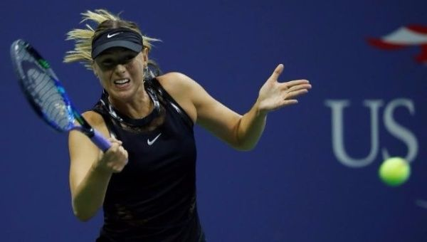 Sharapova advances into US Open last 16, Cilic ousted