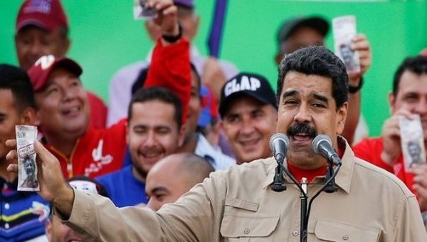 Maduro calls for restructuring Venezuela's foreign debt