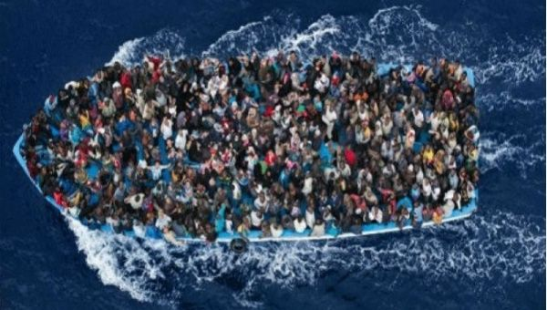 A boat carrying migrants in the Mediterranean