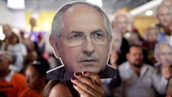 Caracas mayor held since 2015 escapes house arrest, arrives in Colombia
