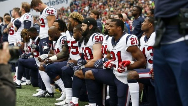 President Donald Trump complains about kneeling, says players are boss in NFL