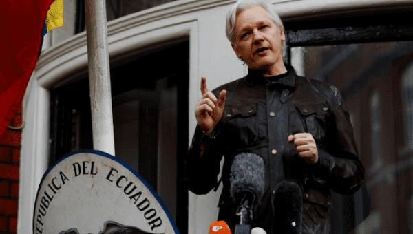 Assange, now Ecuadoran citizen, still can't leave embassy
