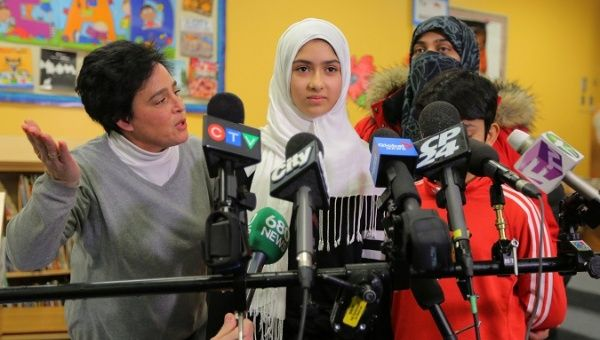 Khawlah Noman speaks to reporters with her mother at her school after she told police that a man cut her hijab with scissors in Toronto Ontario Canada Jan. 12 2018