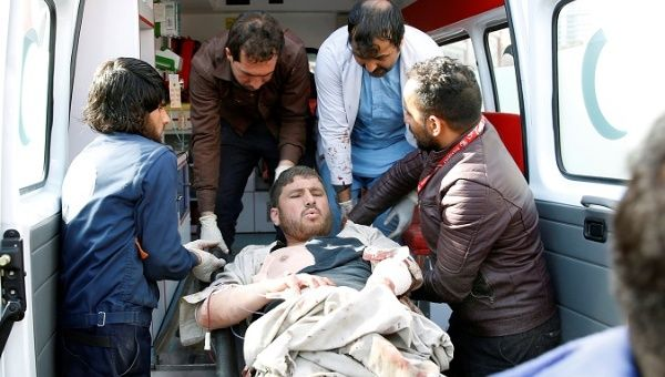 Attacker driving ambulance packed with explosives kills dozens in Kabul