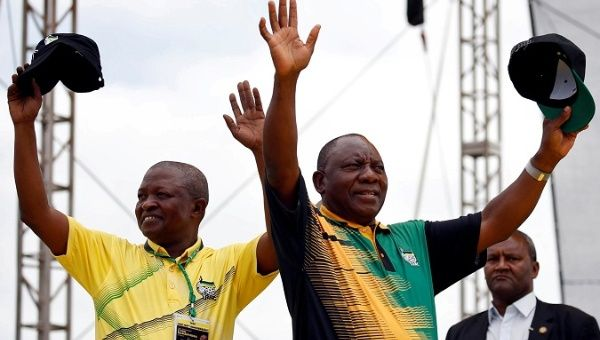President Ramaphosa and his ANC party deputy President Mabuza wave to supporters ahead of the ANC