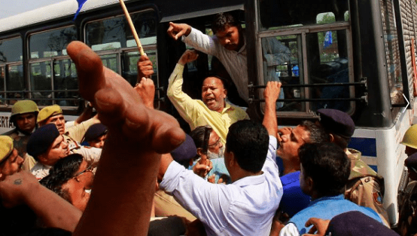 People belonging to the Dalit community shout slogans as they are detained by the police during a protest following a nationwide strike called by Dalit organizations