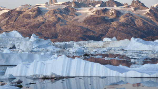 Massive melting iceberg threatens Greenland village