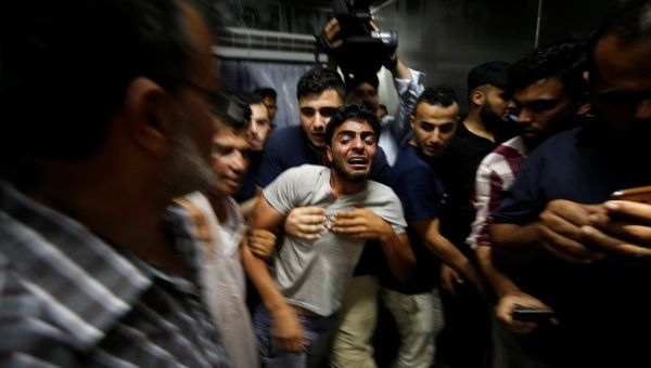 Israel and Hamas exchange fire after day of deadly protests