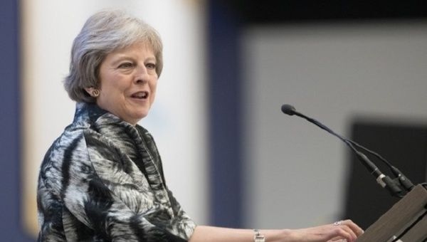UK PM May narrowly avoids defeat in parliament on European Union trade laws