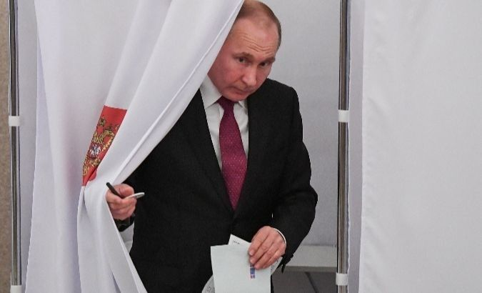 Russian President Vladimir Putin at a polling station during the presidential election in Moscow Russia