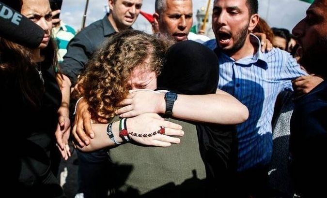 Ahed Tamimi hugs her mother